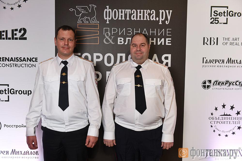 сотрудники отдельного батальона №3УГИБДД капитан полиции Дмитрий Конвисаров и ст.лейтенант полиции Вячеслав Шарабуркин